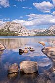 Granite domes of Yosemite reflected in the calm waters of Tenaya Lake, Yosemite National Park, UNESCO World Heritage Site, California, United States of America, North America