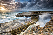 Rocks and crashing waves at Devil's Bridge, a natural arch carved by the sea, Antigua, Leeward Islands, West Indies, Caribbean, Central America