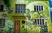 A building painted green with artwork of skull, Santiago, Santiago Metropolitan Region, Chile
