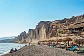 Lounge chairs on a beach, Santorini, Greece