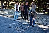 Men doing calligraphy in Tiantan Park, Temple of Heaven, Beijing, China