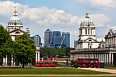 Towers of the Old Royal Naval College with modern Canary Wharf in the background, London, England
