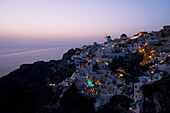 An aerial view of Oia and the windmill at dusk, Oia, Santorini, The Cyclades, The Aegean, The Greek Islands, Greece