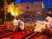 Men sitting, relaxing and talking, Abha, Saudi Arabia