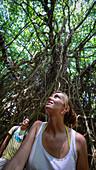Tourists wandering through a giant Banyan tree, Tanna Island, Vanuatu