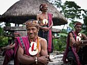 Timorese men in traditional attire at Liurai Village, Timor-Leste