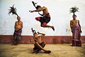 Timorese men in traditional dress, Timor-Leste