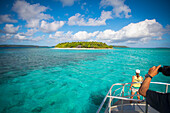 Tourists view Mounu Island from a boat, Vavau, Tonga