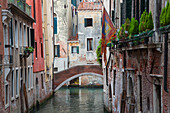 A quaint bridge over a narrow canal, Venice, Italy