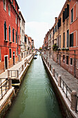 A narrow canal lined with residential buildings, Venice, Italy