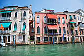 Colourful rustic buildings, along the Grand Canal, Venice, Italy