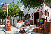 A shop selling local pottery on the island of Sifnos, Sifnos, Cyclades, Greek Islands, Greece