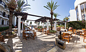 Seating on a patio with palm trees, Paphos, Cyprus