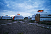 Mongolian Gers (yurts) tourist accommodation at the Ongiin Nuts Ger Camp at dusk, Saikhan-Ovoo, Dundgovi Province, Mongolia