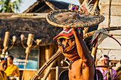 Manggarai man wearing a traditional headdress wrapped with cloth wielding a shield and bamboo whip in a caci, a ritual whip fight, Melo village, Flores, East Nusa Tenggara, Indonesia
