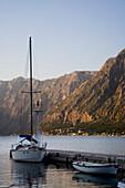Sailing And Rowing Boats Moored At Sunset,Kotor Bay Montenegro.Tif