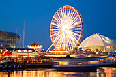 Chicago, Illinois Boat Pull Away From Dock At Navy Pier At Night, Ferris Wheel And Skyline Stage