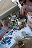 Pouring mint tea, Tunisia's national drink, Djerba, Tunisia