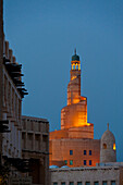 Looking over the Wafi souk to Qatar Islamic Culture Center and Mosque (Fanar) at dusk, Doha, Qatar