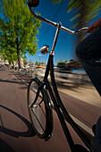 Cycling down cycle path, Amsterdam, Holland