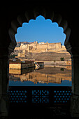Looking out of archway to Amber Fort, Amer, Jaipur, India