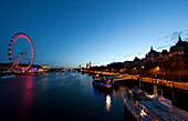 View across the Thames towards The London Eye and Houses of Parliament, Westminster, London, England