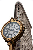 The iconic Flatiron Building and the 5th Avenue Clock, Midtown Manhattan, New York City, New York, United States of America