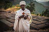 Ethiopian Orthodox Christian pilgrim with cross, Lalibela, Ethiopia