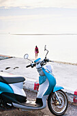 A motor scooter parked on the side of the road at the water's edge, Nathon Beach, Nathon, Ko Samui, Thailand