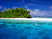 Paddle boarding off a remote island, Marshall Islands