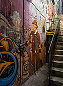 'Colourful murals painted on a wall beside steps; Valparaiso, Chile'