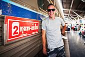 'A tourist gets ready to board a train out of Bangkok's Hualamphong Station (Krungthep); Bangkok, Thailand'