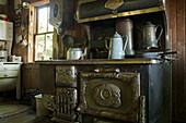 'Old French settlement kitchen and antique wood oven; Trochu, Alberta, Canada'