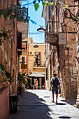 'Pedestrian in an alley in old town; Chania, Crete, Greece'