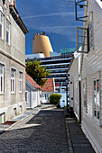 'Cruise ship docked at Stavanger, viewed down narrow side street; Stavanger, Norway'