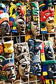 'Close up of colourfully painted Mayan masks hanging on display; Akumal, Quintana Roo, Mexico'