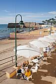 'Restaurant patio at the waterfront; Cadiz de la Frontera, Andalusia, Spain'