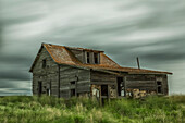 'Long exposure of clouds going over an abandoned house; Val Marie, Saskatchewan, Canada'