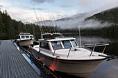 'Fishing boats along a dock; Queen Charlotte Islands, British Columbia, Canada'