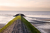 A Runner About To Jog On A Wave Breaker, North Sea, Belgium