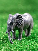Close Up Of Miniature Toy Elephant On Artificial Grass
