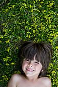 Child Laying On Grass, Toronto, Ontario