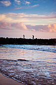 'A father and son fishing off the jetty at Pakala's; Kauai, Hawaii, United States of America'