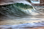 'Motion blur of breaking wave; Hawaii, United States of America'