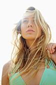 'Girl with long blond windswept hair and a bikini top; Kauai, Hawaii, United States of America'