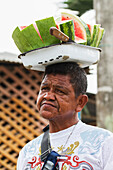 Man carrying a tray with sliced watermelon pieces on his head, San Jacinto de Yaguachi, Guayas, Ecuador