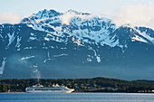 Scenic view of a cruise ship moored at Haines with coastal mountains in the background, Inside Passage, Southeast Alaska