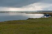 View of fence and coastal waters near Kaktovik, Arctic Alaska
