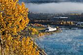 Fog hangs over the Yukon River and the SS Klondike riverboat, Whitehorse, Yukon Territory, Canada