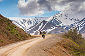 A Woman bicycle touring in Denali National Park, Grassy Pass, Southcentral Alaska